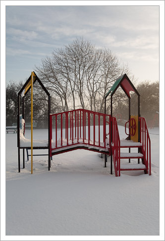 Children's climbing frame in fresh snow